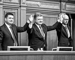 Новый украинский кабмин старательно наступает на заботливо расставленные предшественником грабли (фото: Михаил Палинчак/РИА Новости)