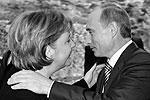 Ангела Меркель целует при встрече Владимира Путина  (фото: ИТАР-ТАСС)
