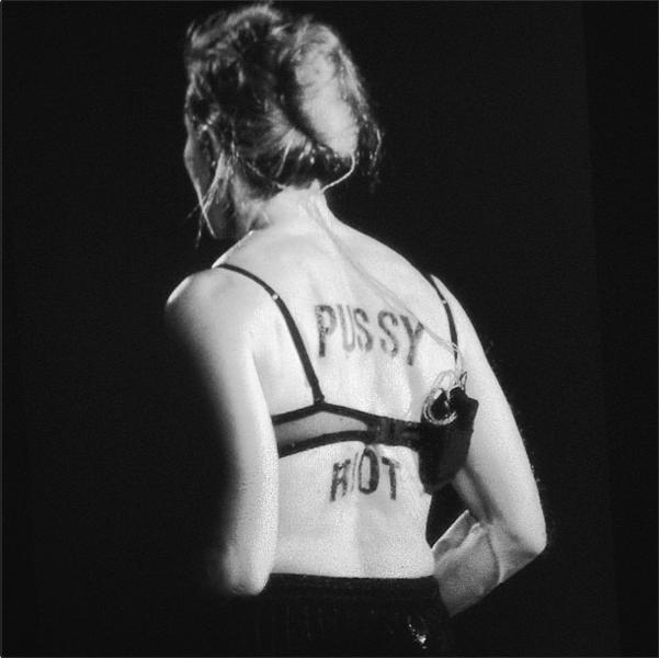 В конце исполнения первой песни Мадонна сняла с себя кофту, осталась в бюстгальтере, повернулась спиной к залу, и каждый смог увидеть, что на ее спине было написано чем-то черным «Pussy Riot»