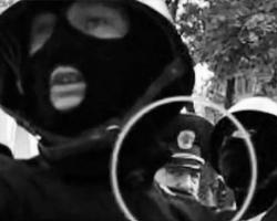Тот самый Фучеджи, который стоит за плечом стреляющего боевика(Фото: кадр Первого телеканала)