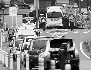 Подозреваемый в массовом убийстве приехал к учреждению на черной машине