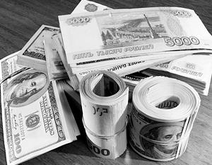Доллар и евро падают к рублю на фоне роста нефти выше 50 долларов за баррель