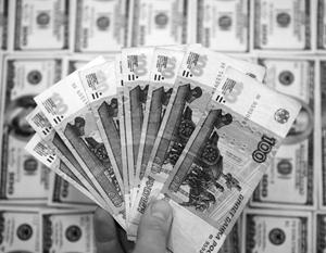 Российский рубль укрепился ниже 60 рублей за доллар, что произошло впервые с июля 2015 года