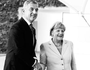 Черногорский правитель Мило Джуканович с канцлером Ангелой Меркель