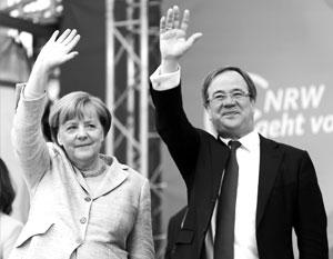 Ангела Меркель и лидер ячейки ХДС в Северном Рейне – Вестфалии Армин Лашет сегодня чувствуют себя победителями