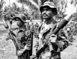 Philippine Muslim rebels hold their grenade launchers as they stand at attention during an assembly at Darapanan, Maguindanao, the main base of the Moro Islamic Liberation Front in the southern island of Mindanao June 4, 2005. The leader of the largest Muslim guerrilla group, Ebrahim Murad, said talks with the government is about 80 percent done with only the ticklish issue on governance remaining.