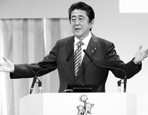Японский премьер оказался миллионером