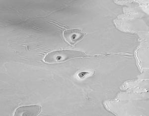 НАСА обнаружило необычные отверстия во льду Арктики