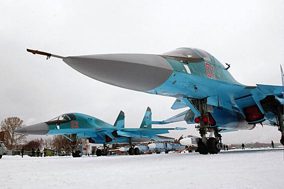 Это фронтовые бомбардировщики Су-34 в количестве 4 машин.