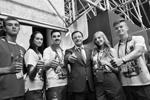 «Люди будут вспоминать этот праздник с теплотой в сердце независимо от того, где живут. Вы стали 33-й командой чемпионата, командой, которая обеспечила себе выход в финал сразу. И которая по-настоящему победила. Вы – волонтеры моего сердца!» – подчеркнул врио губернатора Самарской области Дмитрий Азаров. 13 июня он встретился с командой волонтеров, работавших на стадионе «Самара Арена» и помогавших в приеме гостей города.  Тогда в разгаре был флешмоб в поддержку Станислава Черчесова «Усы надежды» (наклеенные усы можно увидеть на одном из ребят из волонтерской команды) (фото: администрация Самары)