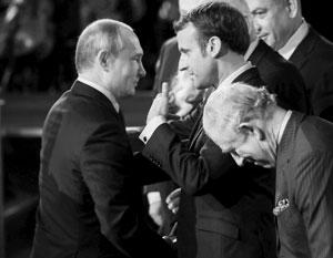 Владимир Путин с Эммануэлем Макроном в Иерусалиме. Справа - Чарльз, принц Уэльский