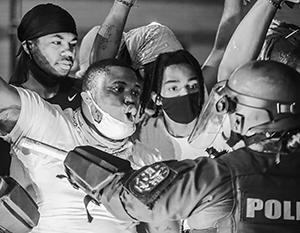 Насилие в Миннеаполисе говорит о глубоком расколе в США