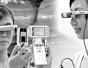 Компания Kowon выпускает дисплей в виде очков (модель MSP-209) для пользователей мобильных телефонов