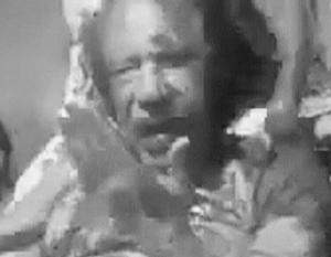 Новые видеокадры подтверждают версию о том, что Каддафи был жестоко казнен