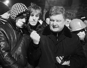 «Шоколадный король» Петр Порошенко, по мнению экспертов, решил на волне протестов подняться на пост премьера Украины