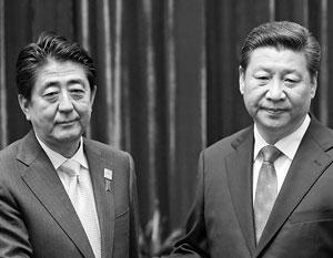 На первой в истории встрече Синдзо Абэ и Си Цзиньпина у обоих были демонстративно кислые лица