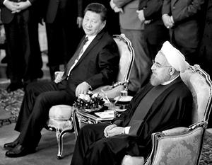 Председатель КНР Си Цзиньпин (слева) стал первым главой государства, посетившим Иран после снятия международных санкций. Справа – президент Ирана Хасан Рухани
