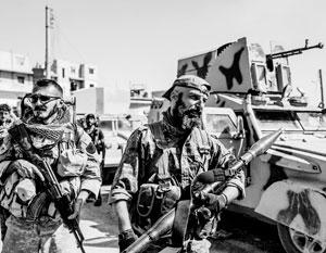 Нищие арабы-сунниты восстали против одетых в американскую экипировку курдов-коммунистов