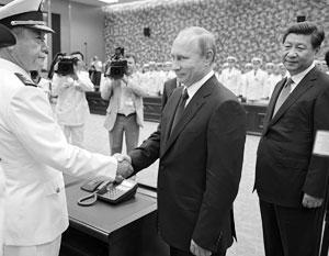 В мае 2014 года в Шанхае Путин и Си Цзиньпин открывали российско-китайские военно-морские учения