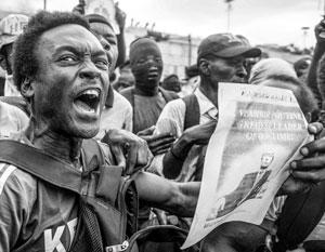 Демонстранты в столице Гаити несли портреты Путина