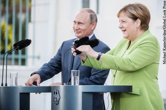 Путин и Меркель обсудили активизацию отношений России и Германии